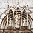 Стоковое фото: Details of entry in gothic catholic church in Pisa, Italy