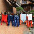 Washed clothes drying on the street side in village — Stock fotografie