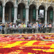 Stock Photo: BRUSSELS, BELGIUM-AUGUST 14: Tourists arrive to see just finished Flower Carpet 2012 on August 14, 2012 in Brussels. This biennial event attracts thousands of to