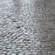 Grey stones on the street as background image - Stock Photo