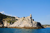 Entry in Portovenere harbour and church san Pietro in Italy in clear calm day — Stock Photo