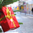 Box for gifts on New Year tree - Stock Photo
