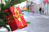 Box for gifts on New Year tree — Stock Photo