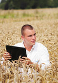 Young biologist in the field — Stock Photo