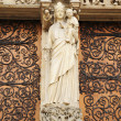 Statue of Mary on entry to Notre Dame de Paris Cathedral — Stock Photo