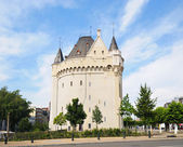 Porte de Hal built in year 1381 with Belgian flag on top — Stock Photo