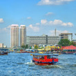 Tourist cruise boat and modern buildings in Bangkok — Stock Photo