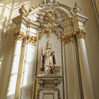 Statue of St. Aubertus, the saint patron of the bakers in Church of Our Lady of the Chapel — Stock Photo