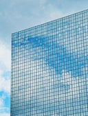 Clouds reflecting in windows — Stock Photo