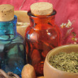 Royalty-Free Stock Photo: Vintage medical bottles and a mix of dry herbs