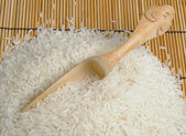 White thai rice with jasmine flavour with wooden spoon — Stock Photo