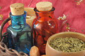 Vintage medical bottles and a mix of dry herbs — Stock Photo