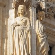 Statue of medieval queen from gothic facade — Stock Photo #26292327