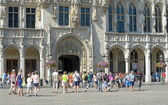 Tourists enter medieval City Hall — Stock Photo