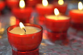 Firing candle in catholic church — Stock Photo