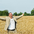 Young person shouting in the field — Stock Photo