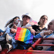 Activists of Gay Pride Parade participate in annual defile with rainbow flag. — Stock Photo #48132531