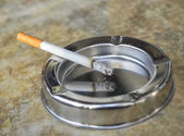 Metal ashtray with a cigarette — Foto de Stock