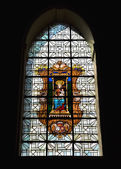 Stained glass window in Chapelle de Bois-Seigneur-Isaac — Stock Photo