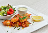 Brochettes with marinated and fried shrimps — Stock Photo