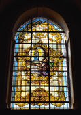 Stained glass window in Sanctuary of Saint Sang known from 15 century. — Stock Photo