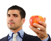 Young person from Middle East holding an apple in his hand isolated on white — Stock Photo