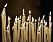 Firing church candles — Stock Photo