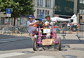 Unidentified participants in fifth Gocarts race in historical center of city — Stock Photo