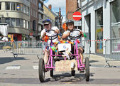 Unidentified participants in fifth Gocarts race in historical center of city. — Stock Photo