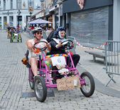 Unidentified participants in fifth Gocarts race in historical center of city Halle, Belgium — Stock Photo