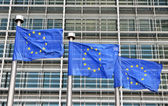 Blue flags of European Union at European Commission building Berlaymont — Stock Photo