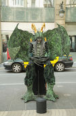 Unidentified street actor poses for tourists as a phantasy monster on Ramblas — Stock Photo