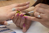 Applying gel at nail during manicure — Stock Photo