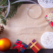 Stock Photo: Christmas card with gifts, balls and tree