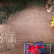 Stock Photo: Christmas decoration with gifts on old wood
