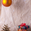 Christmas decoration on old paper — Stock Photo