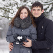 Happy young couple in winter park. — Stock Photo