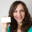 Young smiling woman with blank card — Stock Photo #21436199