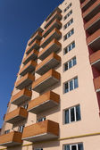 Apartment building on a blue sky — Stock Photo