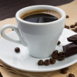 Cup of coffee and beans with chocolate - Stock Photo