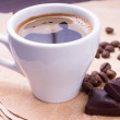 Cup of coffee and beans with chocolate — Stock Photo