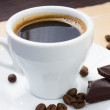 Cup of coffee and beans with chocolate — Stockfoto