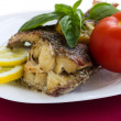 Served grilled fish with lemon — Stock Photo