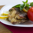 Served grilled fish with lemon and basil with tomato — Stock Photo