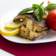Served spicy fish with lemon and basil with tomato — Stock Photo
