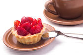 Strawberry dessert in Waffle Basket with Cup of Hot Tea — Stock Photo