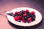 Fresh Summer Berries in white Saucer. Toned Image — Stock Photo