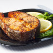 Grilled Salmon Steak with Lemon on Black Dish — Stock Photo