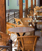 Empty Street cafe with wicker chairs — Stock Photo