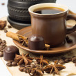 Cup of coffee with coffee beans and chocolate candy — Stock Photo